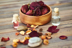 Dayspa products. Dry roses, rose petals, leaves and scented oils Stock Photo