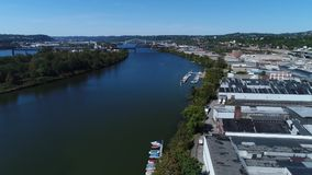 Day Aerial Establishing Shot of Ohio River in Pittsburgh's West End Industrial Park. 9318 A daytime aerial establishing shot of the various businesses and stock footage