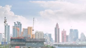 Daytime and crane with building construction in Bangkok city Thailand, Timelapse 4k stock video