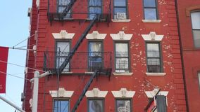 Gritty Apartments Establishing Shot in Manhattan. A daytime establishing shot of apartments located above a restaurant in Manhattan`s Little Italy neighborhood stock video