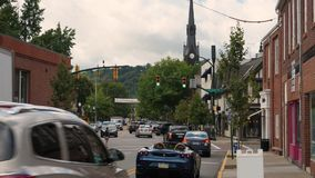 Daytime Establishing Shot Business District in Small Town USA. 9189 SEWICKLEY, PA - Circa September, 2017 - A daytime establishing shot of a business district stock video