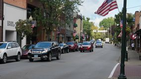 Daytime Establishing Shot Business District in Small Town USA. 9191 SEWICKLEY, PA - Circa September, 2017 - A daytime establishing shot of the business district stock video