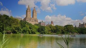 Daytime Establishing Shot of People in Rowboats on the Lake in Central Park
