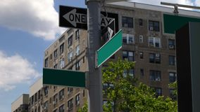 Blank Generic Road Sign Street Locator in Manhattan. A daytime establishing shot of two blank street location signs in Manhattan stock video