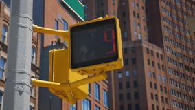 Day Exterior Establishing Shot of Manhattan Walk Sign. A daytime exterior low angle establishing shot of a Manhattan crosswalk walk don't walk sign stock video