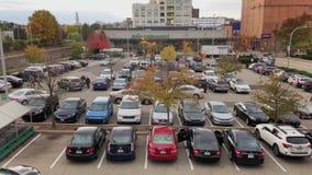 Daytime high angle establishing shot of Wholefoods supermarket. Pittsburgh, PA - circa November, 2017 - A high angle establishing shot of the parking lot outside stock video footage