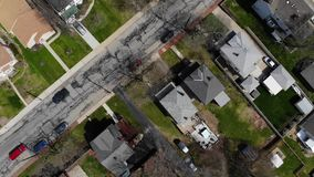Aerial Angled View Straight Down Typical Residential Neighborhood. 10180 A daytime late winter bird's eye angled aerial view straight down on a typical stock video