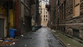 Establishing Shot of Empty Alleyway in a Large City. A daytime overcast establishing shot of an empty alley in a big city stock video footage