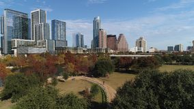 Dramatic rising view of Austin city skyline on autumn day