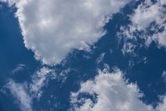 Daytime sky. An atmosphere of white clouds in the sky during the daytime Royalty Free Stock Photo