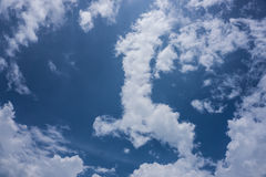 Daytime sky. An atmosphere of white clouds in the sky during the daytime Stock Image