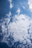 Daytime sky. An atmosphere of white clouds in the sky during the daytime Stock Photo