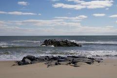 Daytime stock photo of rocks off of beach shoreline Royalty Free Stock Photo