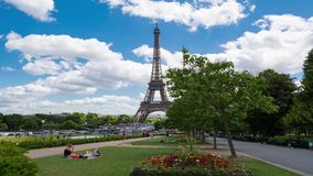 Daytime timelapse of Eiffel Tower, Paris. PARIS, FRANCE - JUNE 2017: People resting on the lawn on the background of the Eiffel Tower, 4k timelapse stock footage