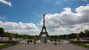 Daytime timelapse of Eiffel Tower, Paris. PARIS, FRANCE - JUNE 2017: People taking photo of Eiffel tower on background, 4k daytime timelapse stock video