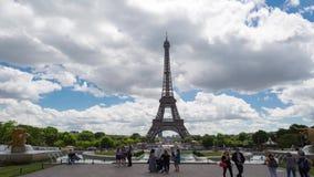 Daytime timelapse of Eiffel Tower, Paris. PARIS, FRANCE - JUNE 2017: People taking photo of Eiffel tower on background, 4k timelapse stock footage