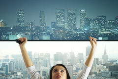 Daytime to nighttime. Abstract image of young woman changing daytime city to nighttime Stock Photography