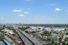 Daytime transportation and river with cargo ship in Bangkok city Thailand Royalty Free Stock Photography