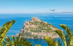 Castello Aragonese - famous landmark near Ischia island, Italy. Daytime view of Aragonese Castle or Castello Aragonese - famous landmark and tourist destination Royalty Free Stock Images
