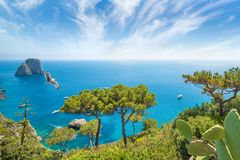 Daytime view of famous Faraglioni rocks from Capri island, Italy Royalty Free Stock Images