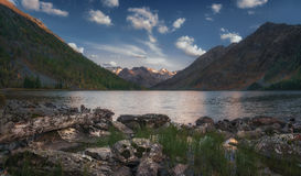 Daytime View From The Shore To The Mountain Lake Reflecting Blue Sky, Altai Mountains Highland Nature Autumn Landscape. Photo. Beautiful Russian Wilderness Royalty Free Stock Photo