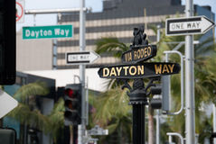 Dayton way Via Rodeo. Intersection road signs and traffic lights Royalty Free Stock Photography
