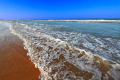 Daytona Beach Florida. Waves crash along the coast on a beautiful day in Daytona Beach, Florida Stock Photos