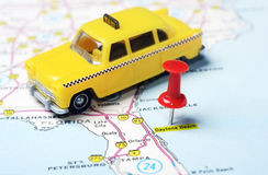 Daytona Beach Florida USA map taxi. Close up of Daytona Beach Florida USA map with red pin and taxi- Travel concept royalty free stock image