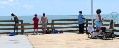 Daytona Beach Pier. DAYTONA BEACH, FLORIDA, UNITED STATES - JUNE 18, 2012: FISHING PIER. Fishermen enjoying the renovated fishing pier at Daytona Beach, Florida stock images