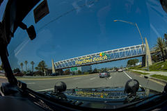 Daytone Beach Sign. Interior of a jeep driving under the sign Daytona Beach. Nice blue skies background Stock Image