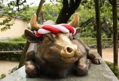 Dazaifu. Japan Dazaifu bull with garland at shinto temple Royalty Free Stock Photography