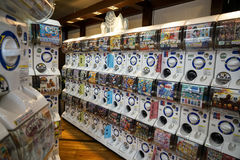 Dazaifu, Japan - May 14, 2017 : Rows of Gashapon machines, popular vending machine dispensed capsule toys showing manga character. Prints in a shop, Dazaifu Royalty Free Stock Image