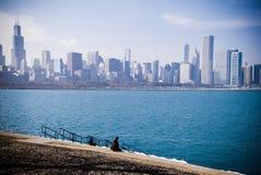 Daze. A boy daze on the coast michigan lake chicago blue city skyline royalty free stock images