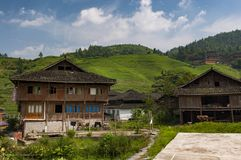 View of the village of Dazhai, with wood houses and rice fields along the slopes of the surrounding mountains in China stock image