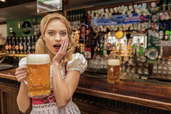 Dazing female holding glass of beer Stock Photography
