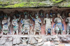 Dazu Bao Ding Mountain Rock Carvings. The Dazu Rock Carvings (Chinese: 大足石刻; pinyin: Dàzú Shíkè) are a series of Chinese religious sculptures and Stock Images