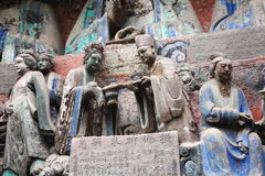 Dazu Bao Ding Mountain Rock Carvings. The Dazu Rock Carvings (Chinese: 大足石刻; pinyin: Dàzú Shíkè) are a series of Chinese religious sculptures and Stock Photo