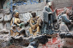 Dazu Bao Ding Mountain Rock Carvings. The Dazu Rock Carvings  are a series of Chinese religious sculptures and carvings, dating back as far as the 7th century A Stock Images