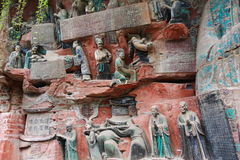 Dazu Bao Ding Mountain Rock Carvings. The Dazu Rock Carvings  are a series of Chinese religious sculptures and carvings, dating back as far as the 7th century A Stock Photography