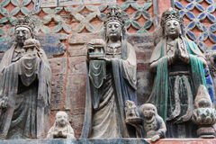 Dazu Bao Ding Mountain Rock Carvings. The Dazu Rock Carvings (Chinese: 大足石刻; pinyin: Dàzú Shíkè) are a series of Chinese religious sculptures and Royalty Free Stock Image