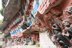 Dazu Bao Ding Mountain Rock Carvings. The Dazu Rock Carvings are a series of Chinese religious sculptures and carvings, dating back as far as the 7th century A.D Stock Photo