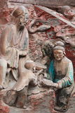Dazu Bao Ding Mountain Rock Carvings. The Dazu Rock Carvings  are a series of Chinese religious sculptures and carvings, dating back as far as the 7th century A Royalty Free Stock Photo