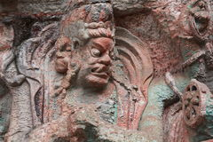 Dazu Bao Ding Mountain Rock Carvings. The Dazu Rock Carvings  are a series of Chinese religious sculptures and carvings, dating back as far as the 7th century A Stock Photo