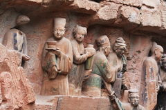 Dazu Bao Ding Mountain Rock Carvings. The Dazu Rock Carvings  are a series of Chinese religious sculptures and carvings, dating back as far as the 7th century A Royalty Free Stock Photography