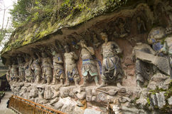 Dazu Bao Ding Mountain Rock Carvings. The Dazu Rock Carvings are a series of Chinese religious sculptures and carvings, dating back as far as the 7th century A.D Royalty Free Stock Photography