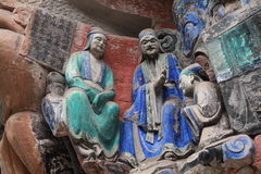 Dazu carvings. Ancient dazu carvings,near Chongqing , China. Original carvings date back to 892 AD Royalty Free Stock Photos