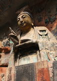 Dazu Rock Carvings. The carving is named Sakyamunis filial piety. It is in Baodingshan carvings, important part of Dazu rock carvings. They was made in Song Stock Photography