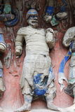 Dazu Rock Carvings. The Dazu Rock Carvings  are a series of Chinese religious sculptures and carvings, dating back as far as the 7th century A.D., depicting and Stock Images