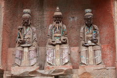 Dazu  Rock Carvings. The Dazu Rock Carvings (Chinese: 大足石刻; pinyin: Dàzú Shíkè) are a series of Chinese religious sculptures and carvings, dating Stock Photo