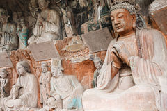 Dazu Rock Carvings. The Dazu Rock Carvings (Chinese: 大足石刻; pinyin: Dàzú Shíkè) are a series of Chinese religious sculptures and carvings, dating back stock photos